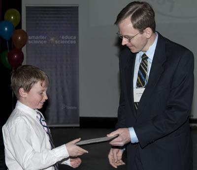 Jeff Regan from Bell presents an award